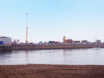 The Fairground rides on the West Pier on Regatta Monday Photo